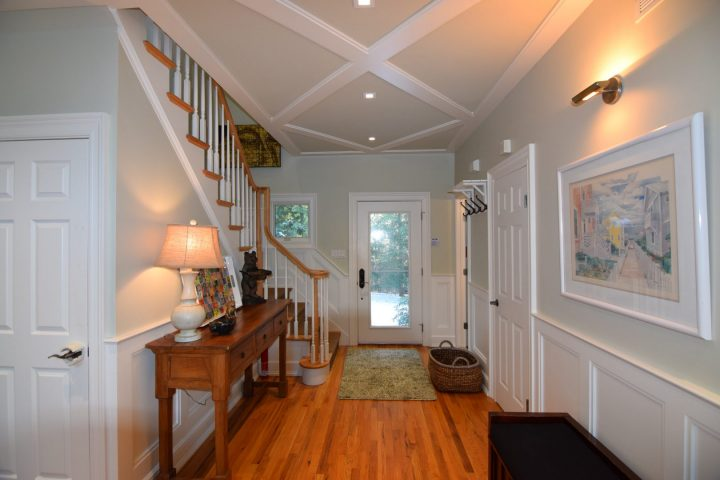 Stairs, entrance hall, front door as seen from the great room of Hamptonsetaway rental house.