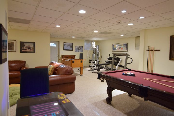 Recreation room showing game, media and gym areas in the Hamptons rental, HamptonsGetaway.