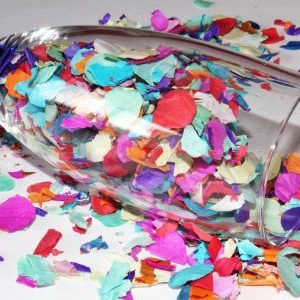 New Year's Confetti spilling from wine glass