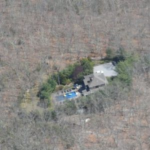 Aerial view of HamptonsGetaway showing house is surrounded by extensive woodland.