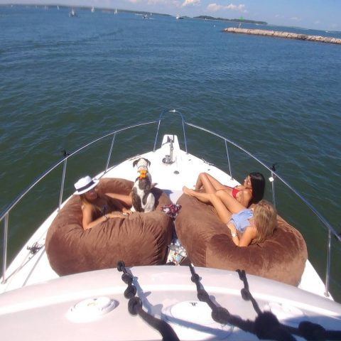 Lounge outside on the foredeck on cushy bean bags built for boats.