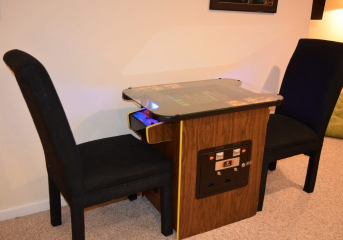 Ms. Pac-Man arcade table in the recreation room of HamptonsGetaway rental house.