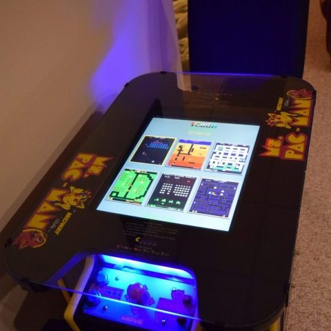 The recreation room Ms. Pac-Man video console with sixty 1980s video games in HamptonsGetaway rental house.