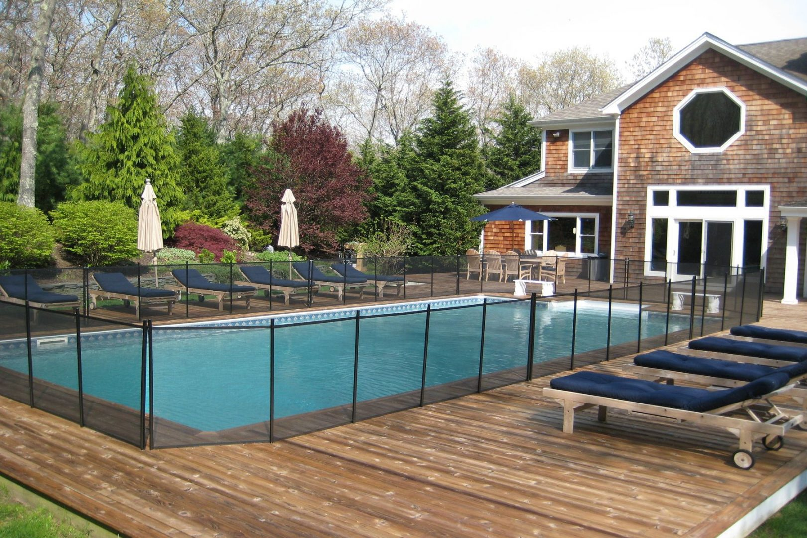 Saltwater pool with optional safety fencing, and deck close up.
