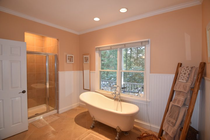 First floor master bath showing claw tub and glass standalone shower at HamptonsGetaway, a Hamptons rental.
