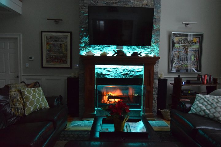 Working fireplace with multi-hued fiber optic lighting.